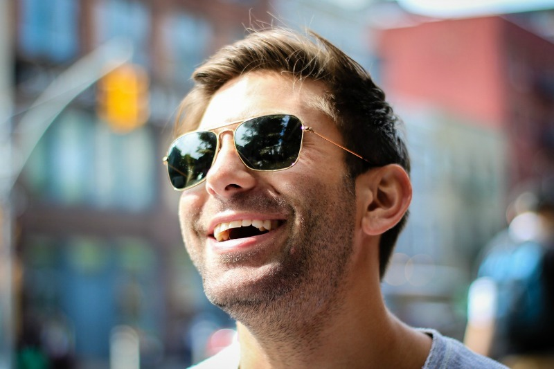 man in sunglasses smiling