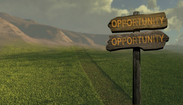 Sign that has the word opportunity pointing in both directions