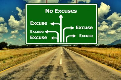 """Road sign that says """"No Excuses"""""""