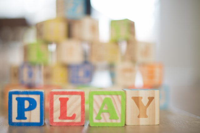 "Set of letter blocks set up that spell ""Play"""
