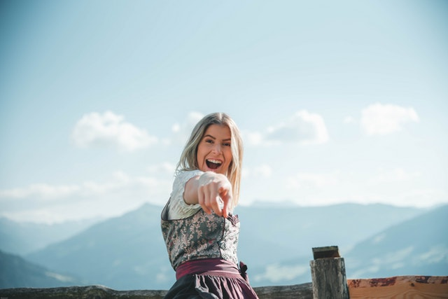 Woman pointing at camera and smiling